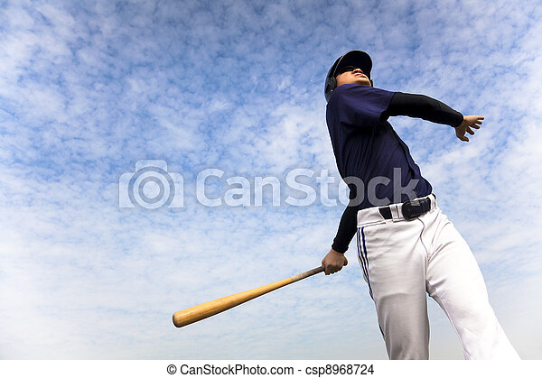 baseball player taking a swing with cloud background - csp8968724