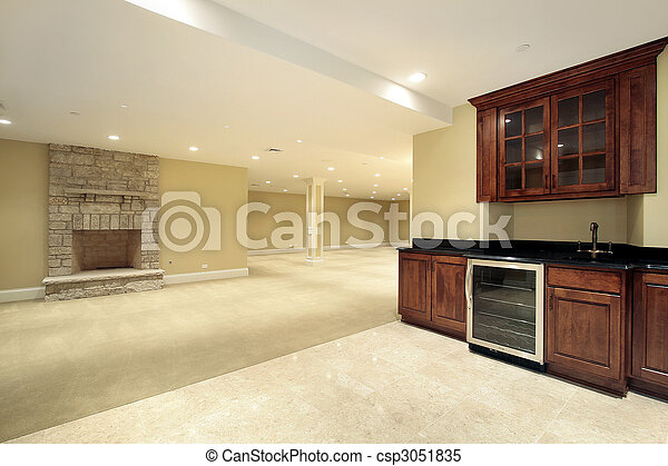 Basement with bar and fireplace - csp3051835