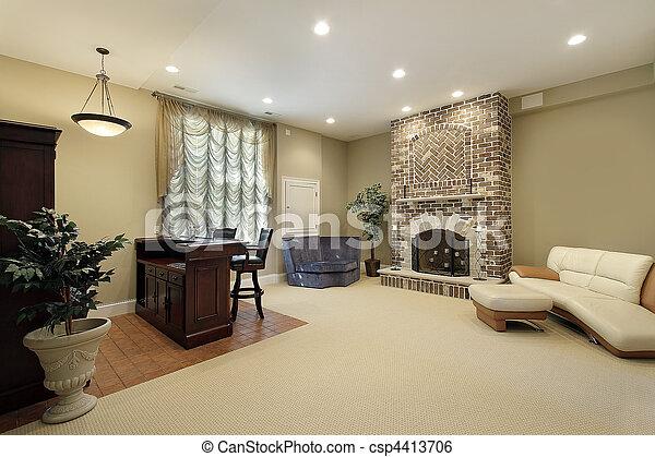 Basement with brick fireplace - csp4413706
