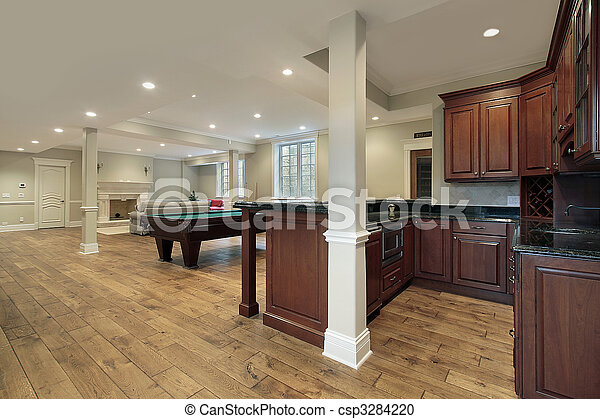 Basement with fireplace and bar - csp3284220
