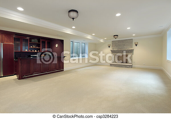 Basement with fireplace and bar - csp3284223
