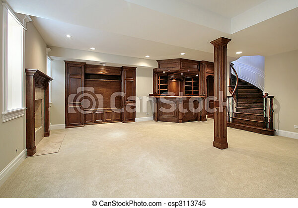 Basement with wood cabinetry - csp3113745