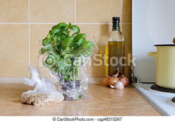 Basil in a pot, with Pinoli - csp48315267