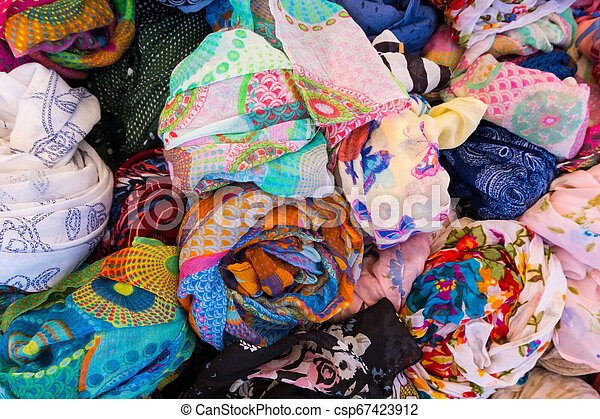 Basket full of colorful women clothes. - csp67423912