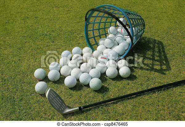 basket of driving range golf balls golf balls pouring out of basket rh canstockphoto com Core Golf Balls Wooden Practice Core Golf Balls Wooden Practice