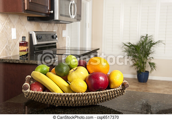 Basket of fresh fruit in modern kitchen - csp6517370