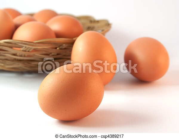Basket with chicken eggs with one in front - csp4389217