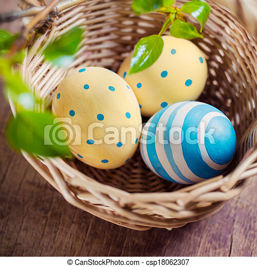 Basket with Easter eggs - csp18062307
