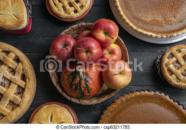 Basket with fruits and many sweet pies. Top view. Homemade traditional desserts. - csp63211783