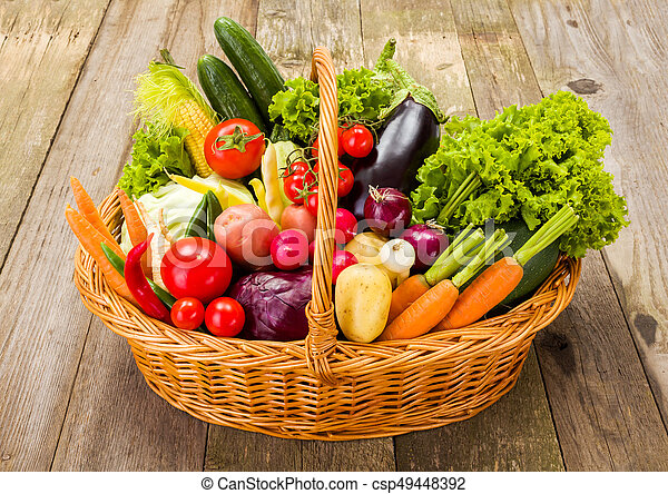 Basket with various fresh vegetables - csp49448392