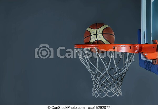 basketball ball and net on grey background - csp15292077