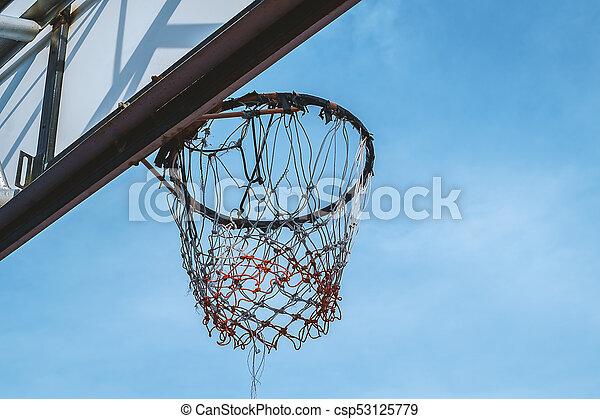Basketball hoop against blue sky - csp53125779