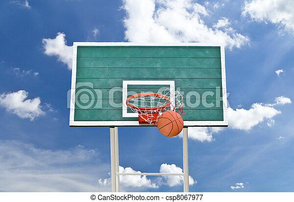 basketball hoop against blue sky - csp8067977