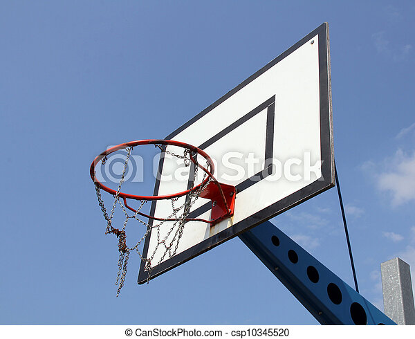 Basketball hoop against blue sky - csp10345520