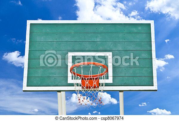 basketball hoop against blue sky - csp8067974