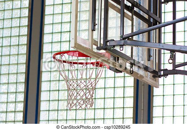 Basketball hoop in a gymnasium - csp10289245