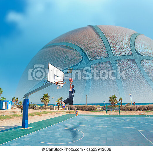 basketball player dunking by the sea - csp23943806