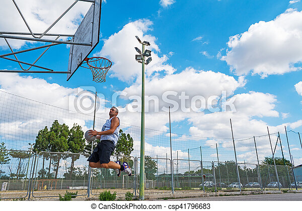basketball player jumping to the hoop - csp41796683