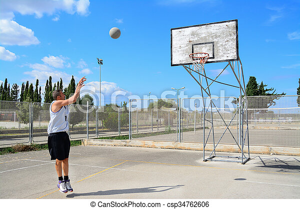 basketball player practicing jump shot - csp34762606