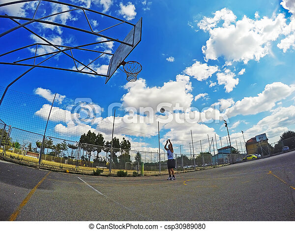 basketball player shooting in a playground - csp30989080