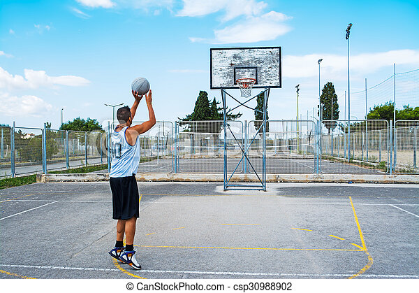 basketball player shooting in a playground - csp30988902
