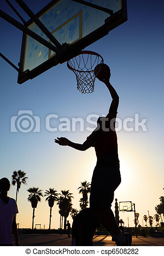 Basketball player silhouette at sunset - csp6508282