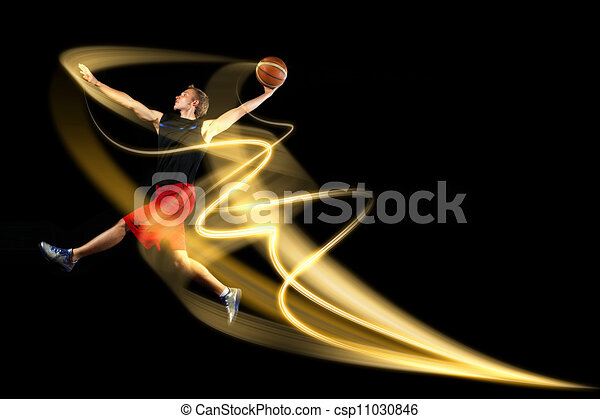 Basketball player with a ball - csp11030846
