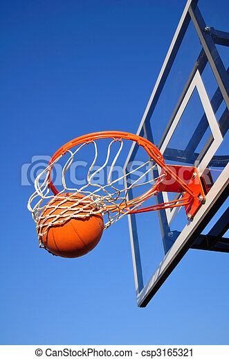 Basketball Shot Falling Through the Net, Blue Sky - csp3165321