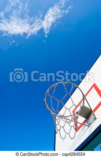 Basketball stands under blue sky - csp4284554