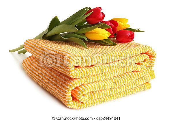 Bath towel with fresh tulips - csp24494041