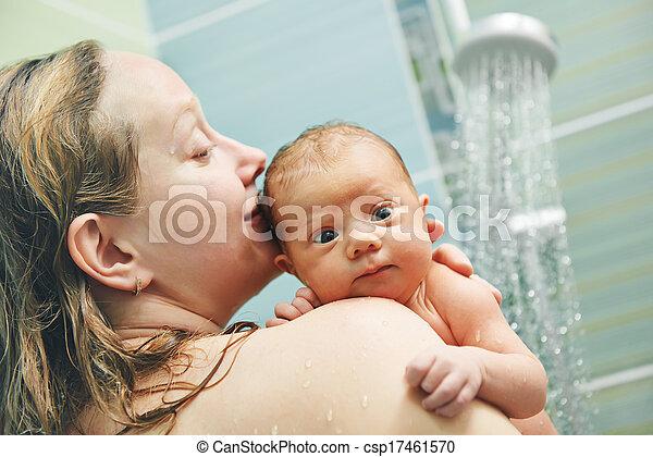 Bathing newborn baby in shower. Bathing newborn baby with mother in ...