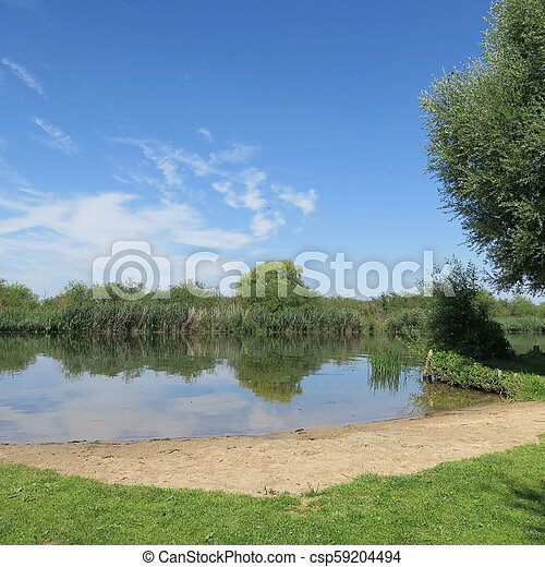 Bathing place without people in beautiful nature on the river Peene in Northern Germany Mecklenburg-Vorpommern - csp59204494