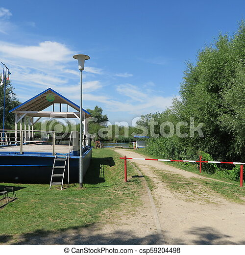 Bathing place without people in beautiful nature on the river Peene in Northern Germany Mecklenburg-Vorpommern - csp59204498