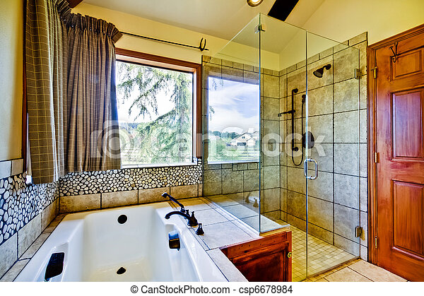Bathroom with natural tiles and glass shower - csp6678984