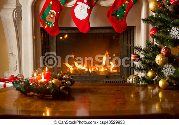 Beautiful Christmas Background.Baubles On Christmas Tree In Front Of Burning Fireplace Beautiful Christmas Background