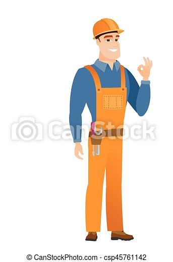 Lächelnder Bauarbeiter zeigt okay Zeichen. - csp45761142