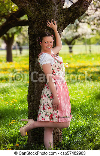 Bavarian girl in dirndl - csp57482903