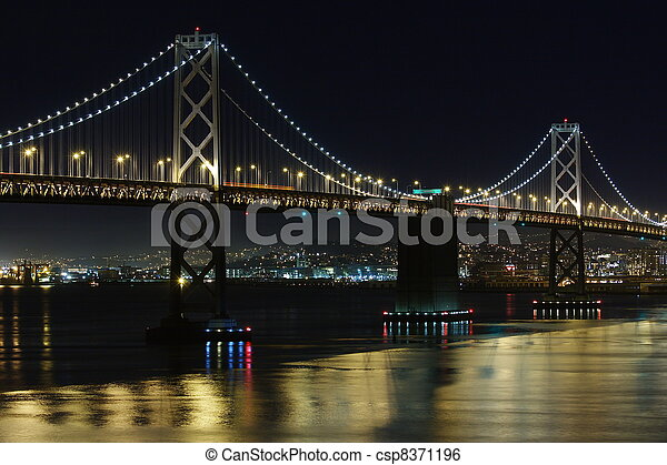 Bay Bridge at night seen from Treasure Island - csp8371196