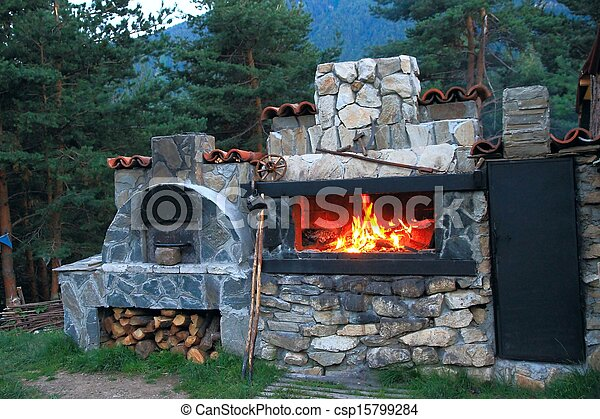 Bbq oven made of stone in the cou bbq oven made of stone for Barbecue en dur exterieur