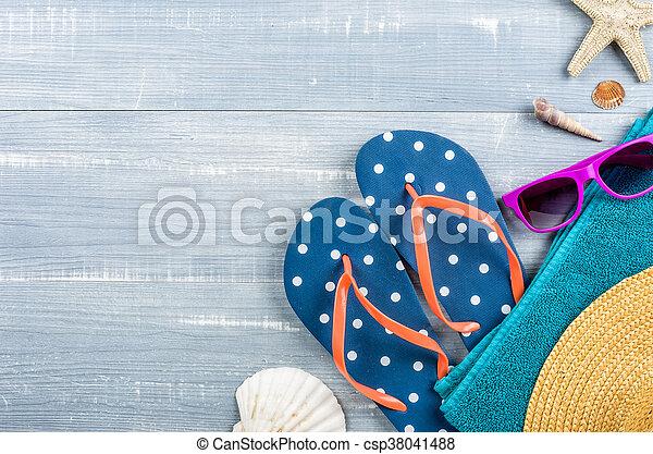Beach accessories on a blue wooden background - csp38041488