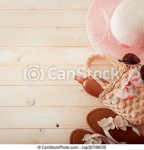 beach accessories on a wooden background - csp30748039