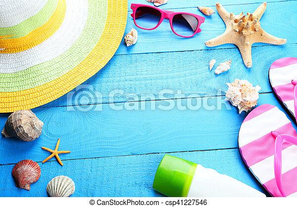 Beach accessories on blue wooden background - csp41227546
