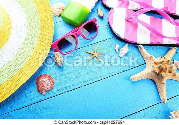 Beach accessories on blue wooden background - csp41227694