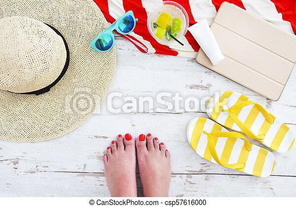 Beach accessories on white wooden background - csp57616000