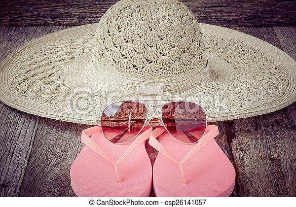 beach accessories on wooden board background - csp26141057