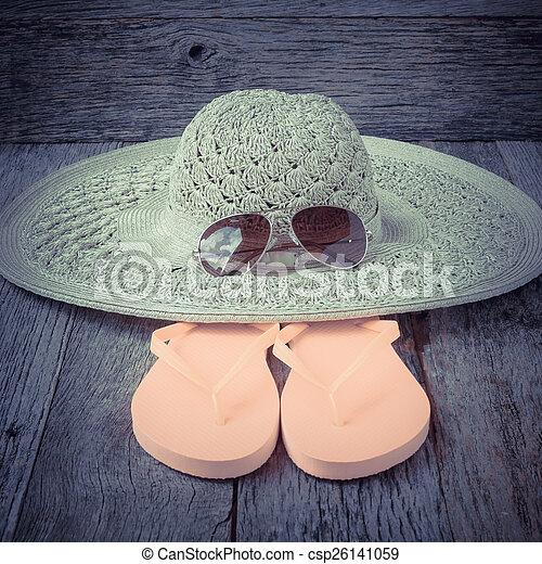 beach accessories on wooden board background - csp26141059