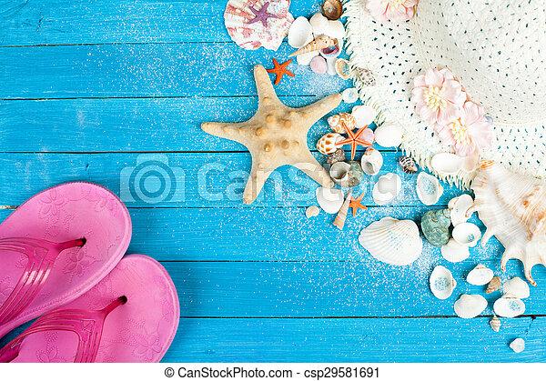 beach accessories on wooden board - csp29581691