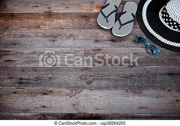beach accessories on wooden board - csp38264203