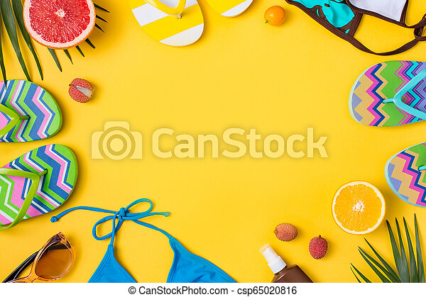 Beach accessories on yellow background - csp65020816
