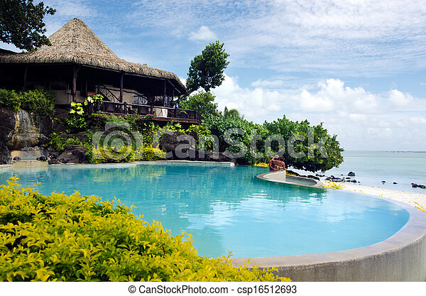 Beach bungalow in tropical pacific ocean Island. - csp16512693